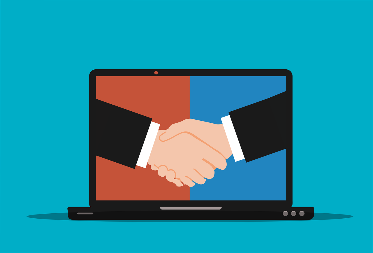 shaking hands on laptop display graphic illustration