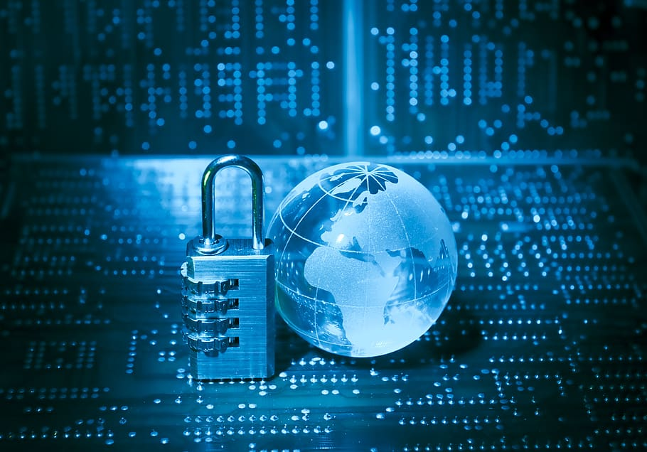 a globe and a lock with cyber background